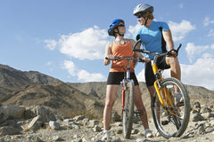 Young Couple On Bicycles In Mountains Royalty Free Stock Image