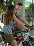Young couple with bicycles Stock Image