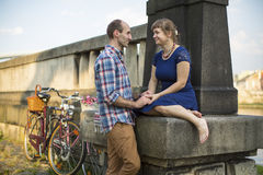 Young couple with bicycles sitting on the promenade. Love. Stock Photography