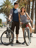 Young couple with bicycles Stock Photos