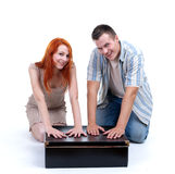 Young couple with big black box Royalty Free Stock Image