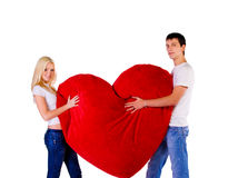 Young couple with a big red heart Stock Photography