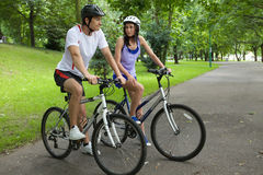 Young couple on bike Royalty Free Stock Photography