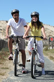 Young couple on bike ride Stock Photo