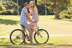 Young couple on a bike ride looking at camera Royalty Free Stock Images