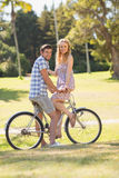 Young couple on a bike ride looking at camera Royalty Free Stock Image