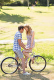 Young couple on a bike ride in the park Royalty Free Stock Photos