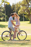 Young couple on a bike ride in the park Royalty Free Stock Photography