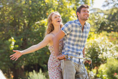 Young couple on a bike ride in the park Stock Photography