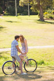 Young couple on a bike ride in the park Royalty Free Stock Photo