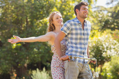 Young couple on a bike ride in the park Stock Photos