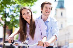 Young couple on bike Stock Image