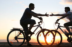 young couple on bikes Stock Photo