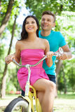 Young couple biking. Royalty Free Stock Photo