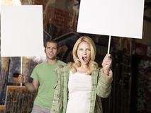 Young Couple With Blank Demonstration Placards Stock Image