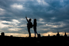 Young couple blow bubbles on sunset Stock Images