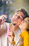 Young couple blowing bubbles Stock Photo