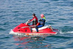 Young couple on board a large jetbike Royalty Free Stock Images