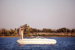 Young couple on the boat stock images