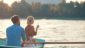 Young couple on vacation. Young couple in a boat on vacation Stock Photography