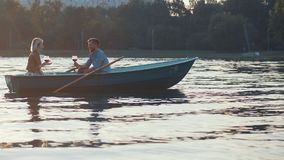 Young couple on vacation. Young couple in a boat on vacation Royalty Free Stock Photography