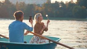 Young couple on vacation. Young couple in a boat on vacation Royalty Free Stock Images