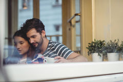 Young couple bonding at cafe. Young couple bonding over coffee at cafe Royalty Free Stock Photo