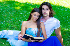 Young couple with book Royalty Free Stock Image