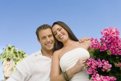 Young Couple At Botanical Garden. Low angle view of a happy young couple at botanical garden Royalty Free Stock Images