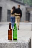 Young couple with bottles of beer Royalty Free Stock Images