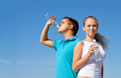 Young couple with bottles of water Royalty Free Stock Photography