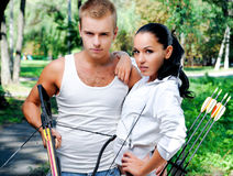 Young couple with a bow and arrows Royalty Free Stock Image