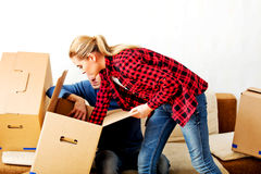 Young couple with boxes - packing or unpacking Royalty Free Stock Photo
