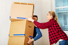 Young couple with boxes - packing or unpacking Stock Photo