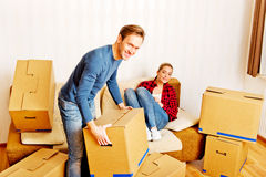 Young couple with boxes - packing or unpacking Royalty Free Stock Image