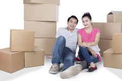 Young couple with boxes on studio Stock Image