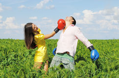 Young couple boxing. On green field Stock Image