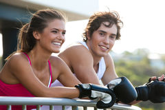 Young Couple in Boxing Gloves Leaning on Railing Stock Photos