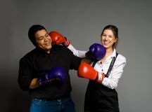 Young couple boxing and smiling Royalty Free Stock Image