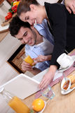 Young couple at breakfast Royalty Free Stock Image