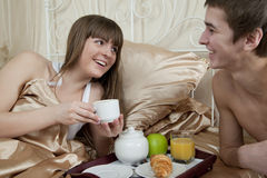 Young couple at breakfast in bed Stock Photos