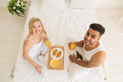 Young Couple Breakfast Sitting In Bed, Happy Smile Hispanic Man And Woman Morning Top Angle View Royalty Free Stock Images