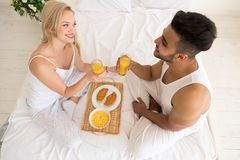 Young Couple Breakfast Sitting In Bed, Happy Smile  Hispanic Man And Woman Morning Top Angle View Stock Photos