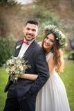Bride groom flowers smile wedding posing royalty free stock photography