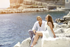 Young couple bride and groom smiling and relaxing near sea, Naples, Italy Stock Images