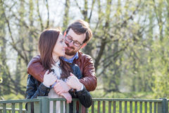 Young couple on bridge Stock Images