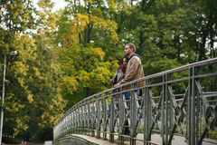 Young couple on a bridge in the fall Royalty Free Stock Photography
