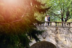 Young couple on the bridge in the park. Stock Photography