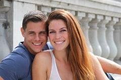 Young Couple Bridge. Young couple sitting on a bridge royalty free stock photo