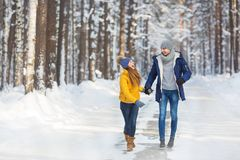 Young couple in a bright clothes walk and laught in a forest. Young couple in a bright clothes walk and laught in forest Royalty Free Stock Photos